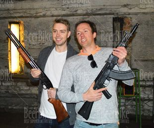 Posing with AK-47 and shotgun